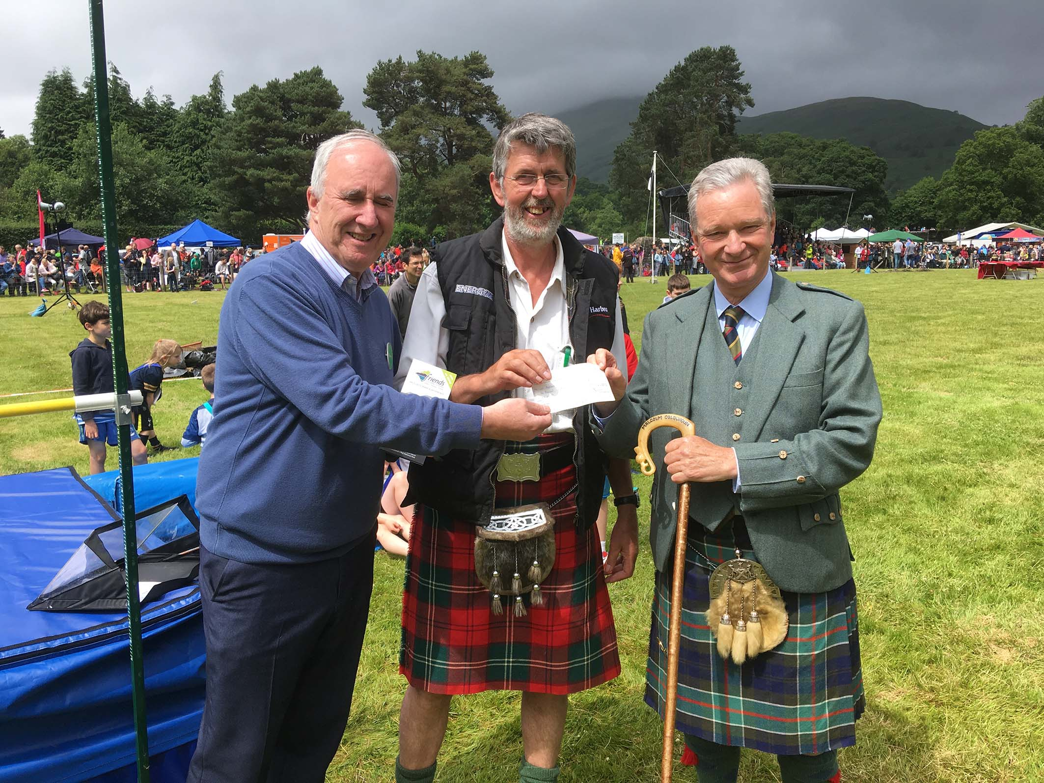 James Fraser, Chairman of Friends of Loch Lomond and The Trossachs (left), hands over the cheque to Bobby Lennox (centre) and Sir Malcolm Colquhoun.