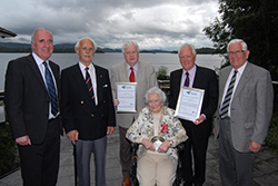 Pictured with Hannah (centre seated) at a civic reception in her honour in 2012 are left to right are Chairman James Fraser, Honorary Vice-Presidents Professor Gavin Arneil, Billy Petrie and Lord John MacFall of Arcluith and Vice-President George Boyd